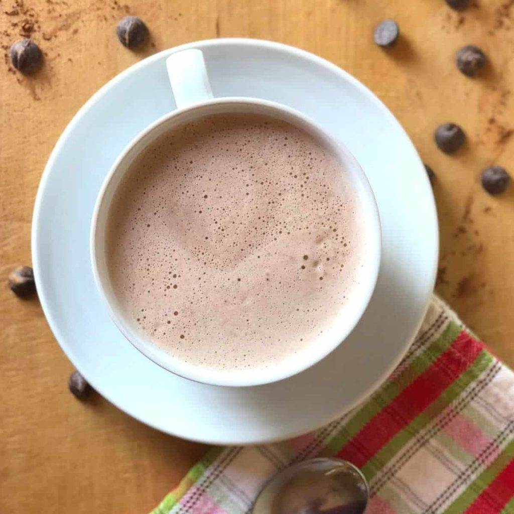 An overhead view of a cup of dairy free hot chocolate