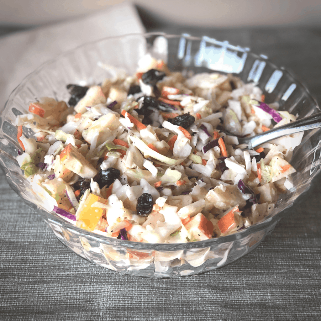 A bowl of dairy and egg free apple coleslaw