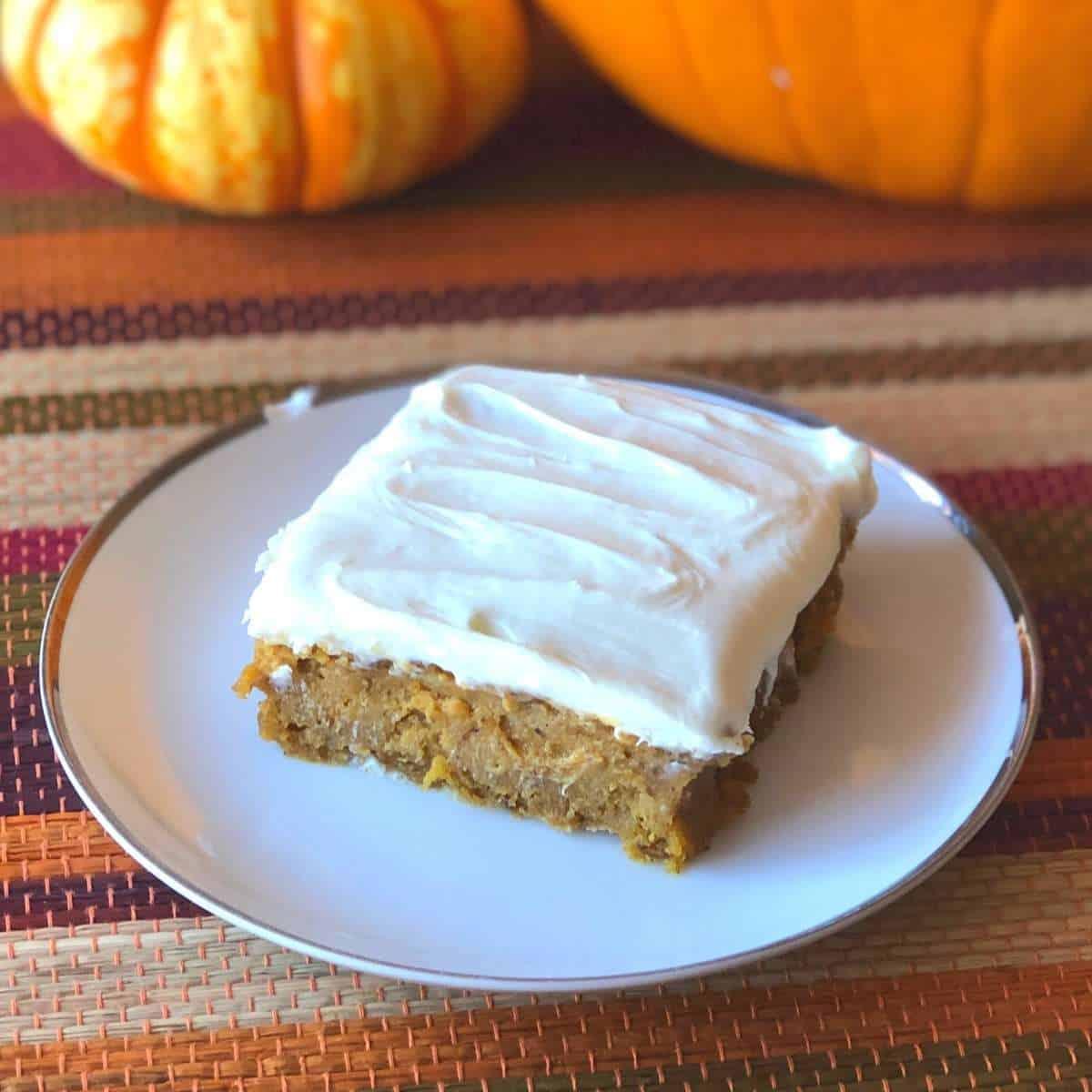 An allergy friendly pumpkin bars on a white plate