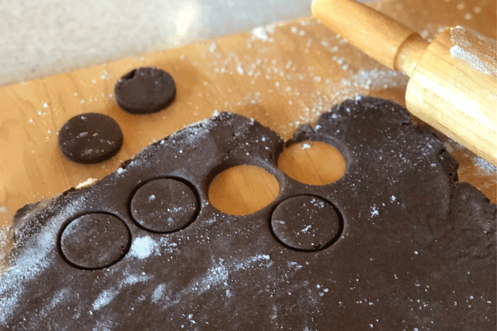 chocolate cookie dough being cut into circles