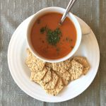 Allergy friendly tomato soup with crackers on the side