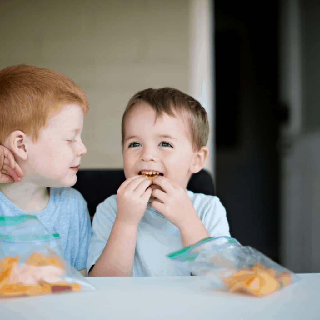 Two boys eating allergy free snacks