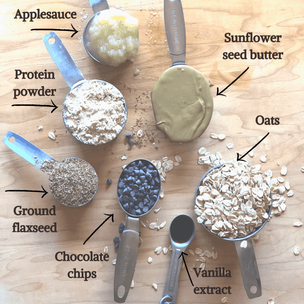 Ingredients for no bake snack bites including applesauce, sunflower seed butter, oats, vanilla, chocolate chips, ground flaxseed, and protein powder.
