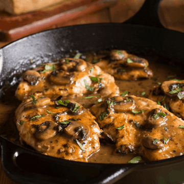 A pan with Veal Marsala garnished with fresh parsley