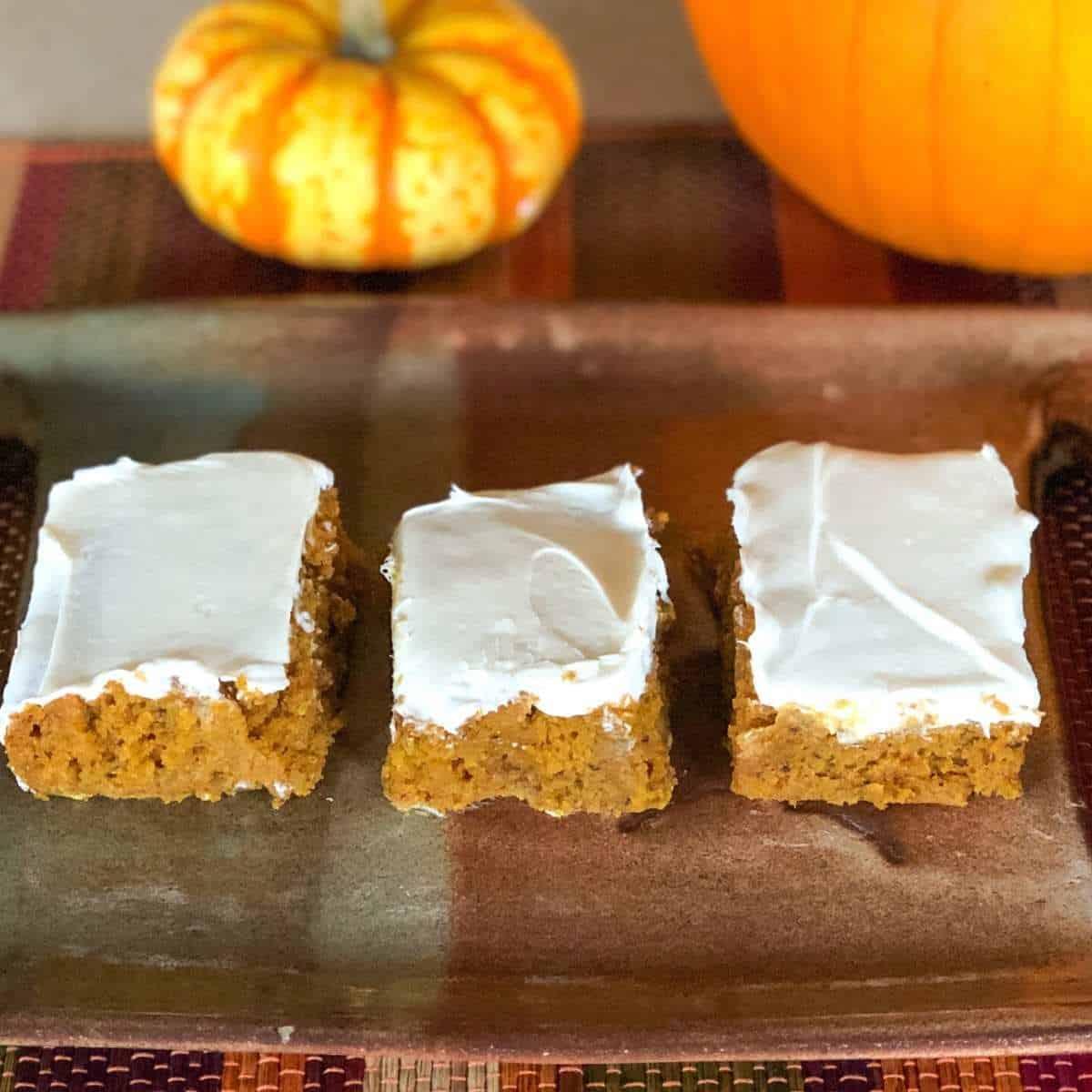 A row of pumpkin bars on a plate