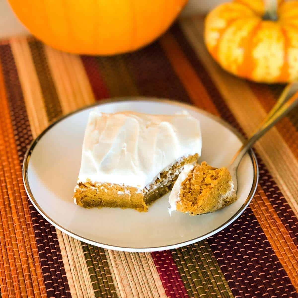 A pumpkin bar on a plate with a fork