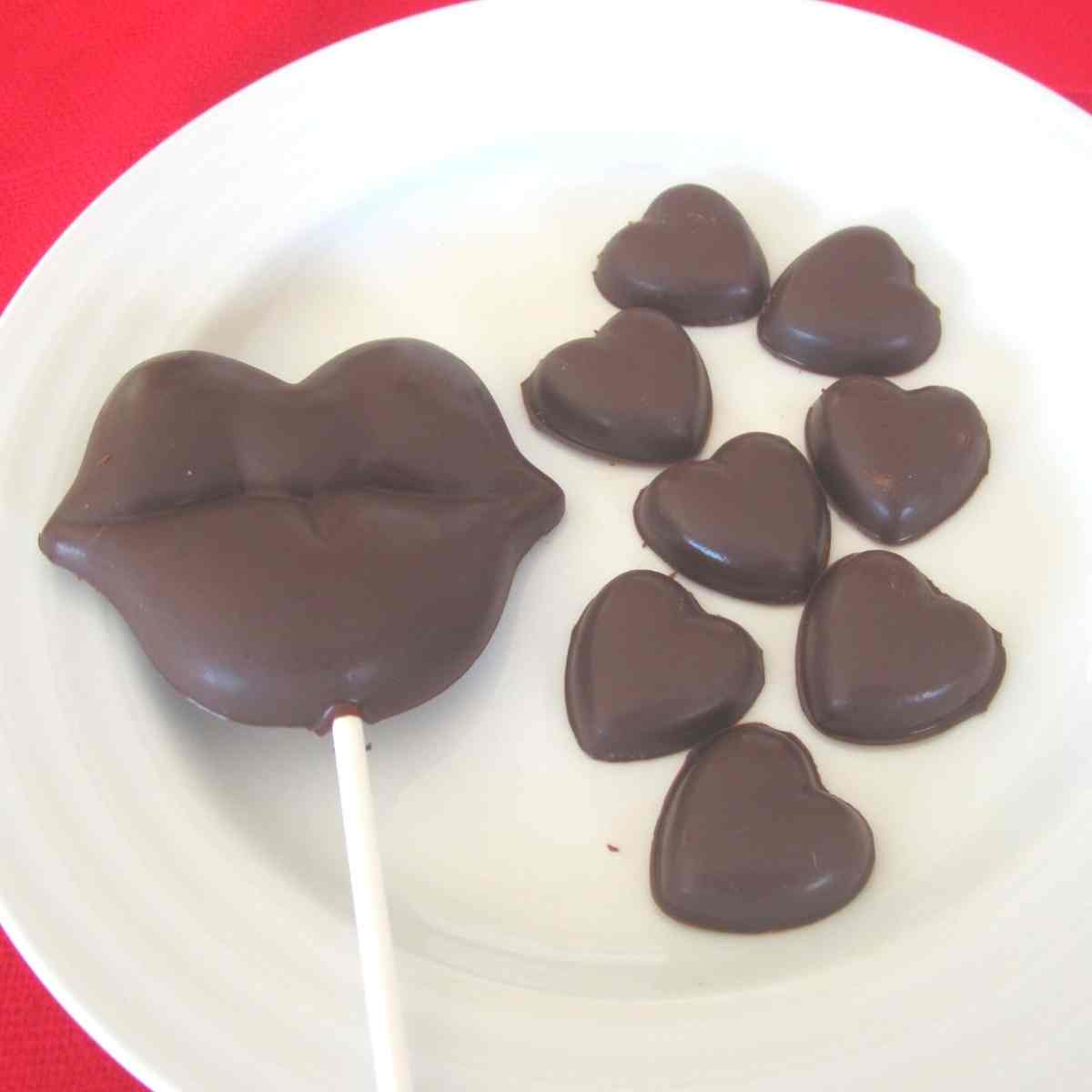 A plate with allergy free chocolate in heart and lip shapes