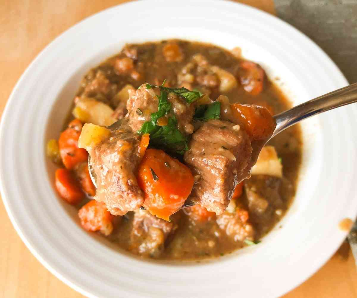 A spoonful of gluten free beef stew.