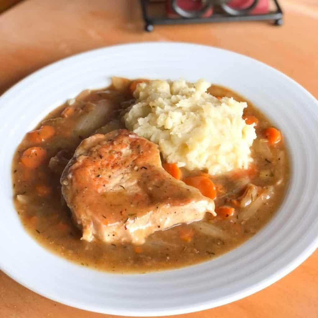 Gluten free pork chops with gravy, vegetables and mashed potatoes