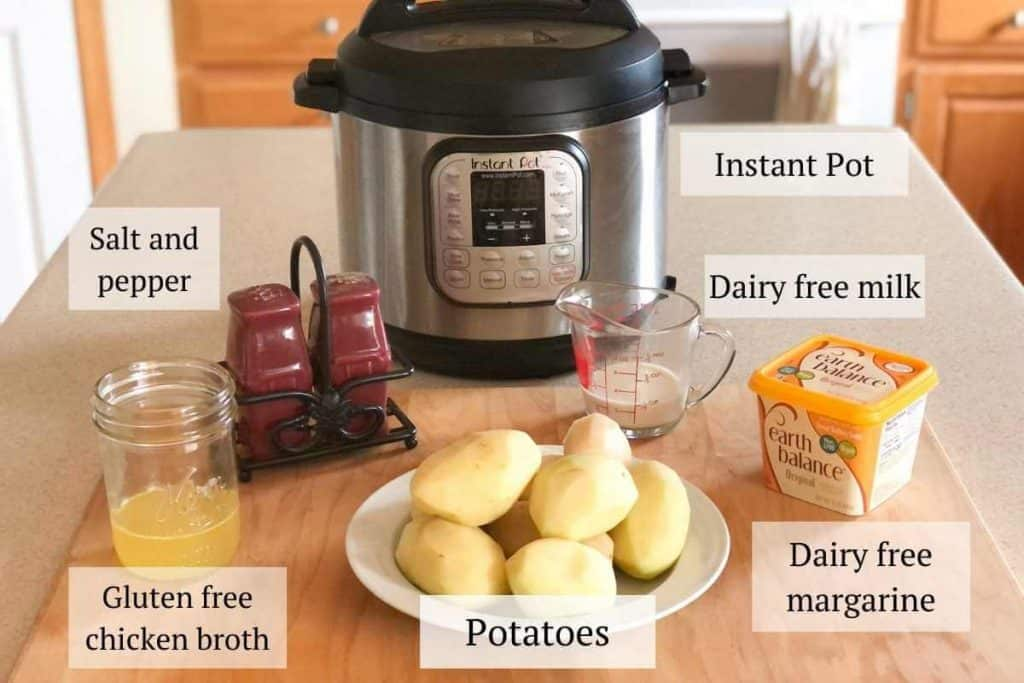Ingredients needed for mashed potatoes including potatoes, broth, dairy free margarine and milk, and an Instant Pot