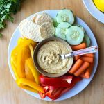 Gluten free hummus on a platter with vegetables